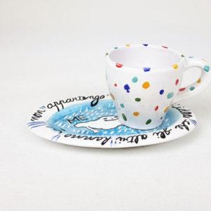 Piattino e tazzina caffè con frase